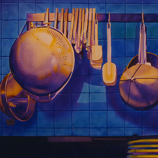 pots and pans hanging on a rack