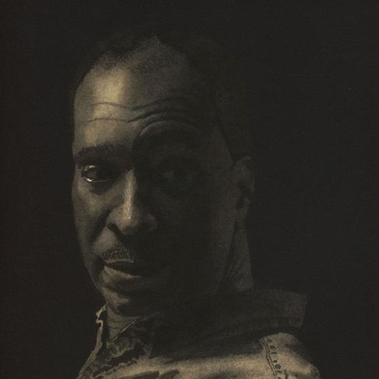 ortrait of man's head looking over his shoulder