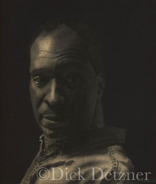portrait of man's head looking over his shoulder