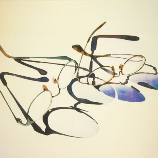 2 pairs eyeglasses casting shadows
