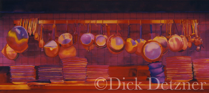 pots and pans hanging on a wall with strong red glow