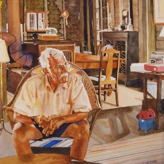 elderly man sitting in a summer cottage