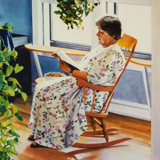 woman in a rocking chair reading a book