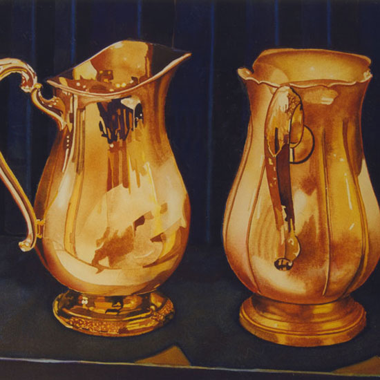 2 ornate silver pitchers