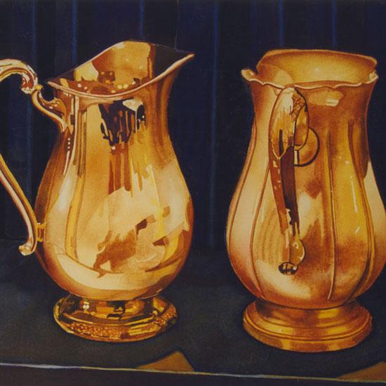 2 ornate silver pitchers