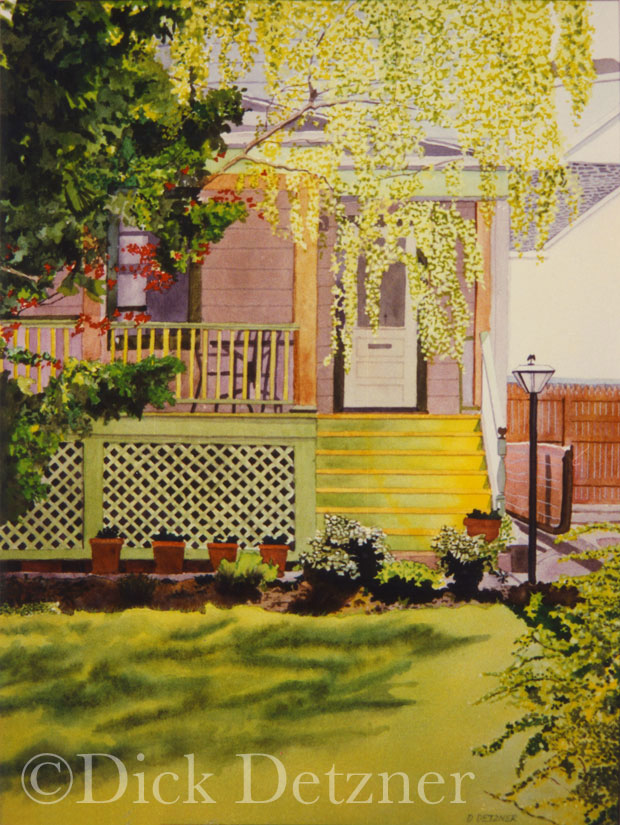 front porch of a house with trees in bloom